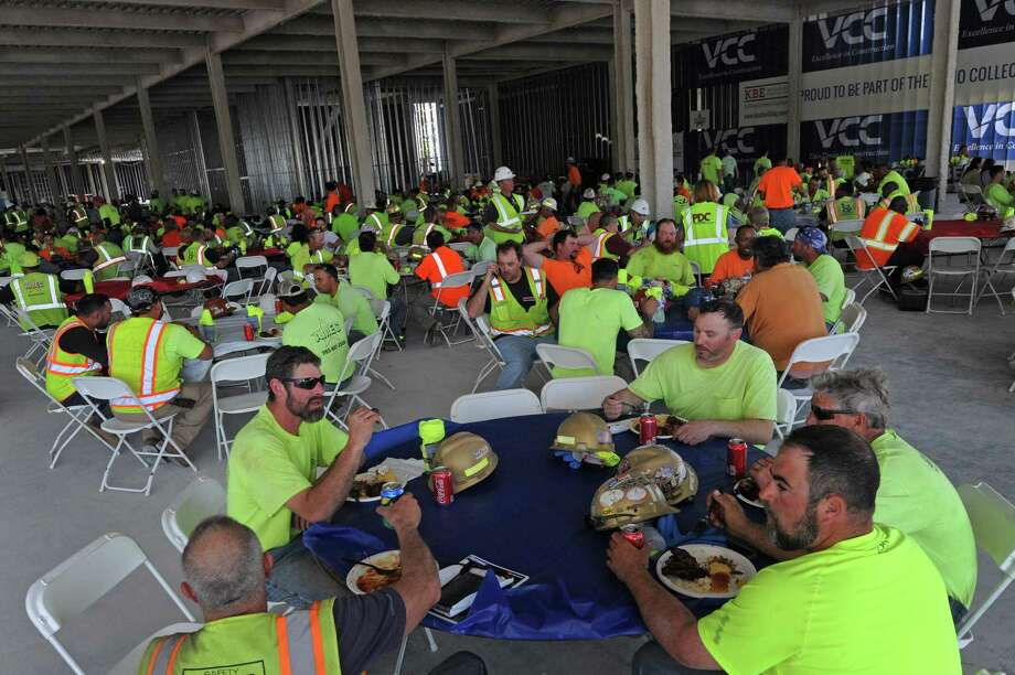 Constrcution workers enjoy a lunch from Bobby Q's restaurant as General Growth Properties holds contractor appreciation event at SoNo Collection construction site off West Avenue and Interstate 95 on Thursday, May 3, 2018, in Norwalk, Conn.  The mall is slated for completion in the fall of 2019. Photo: Erik Trautmann / Hearst Connecticut Media / Norwalk Hour