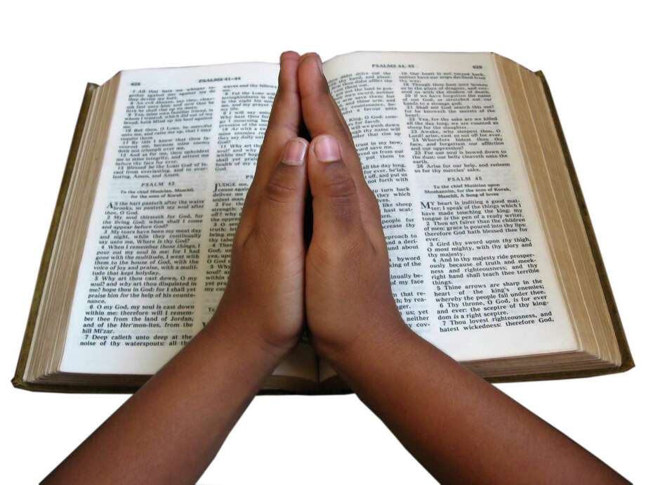 OPEN BIBLE; PRAYING HANDS / handout