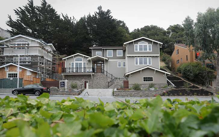 View of 2133 DeAnza Blvd. (middle) which is a single-family home listed for-sale at $2,995,000 on Tuesday, Aug. 21, 2018, in San Mateo, Calif.    The home is 4268 sq. ft. and is a 5 bedroom and 6.0 bath property.