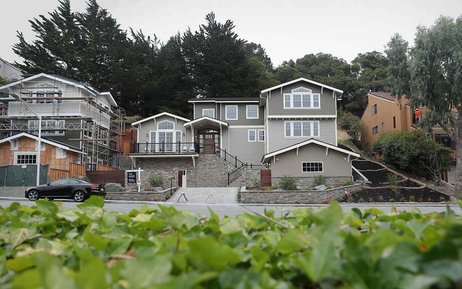 View of 2133 DeAnza Blvd. (middle) which is a single-family home listed for sale at $2,995,000 in August in San Mateo. The home is 4,268 sq. ft. and is a 5 bedroom and 6.0 bath property. Photo: Liz Hafalia / The Chronicle