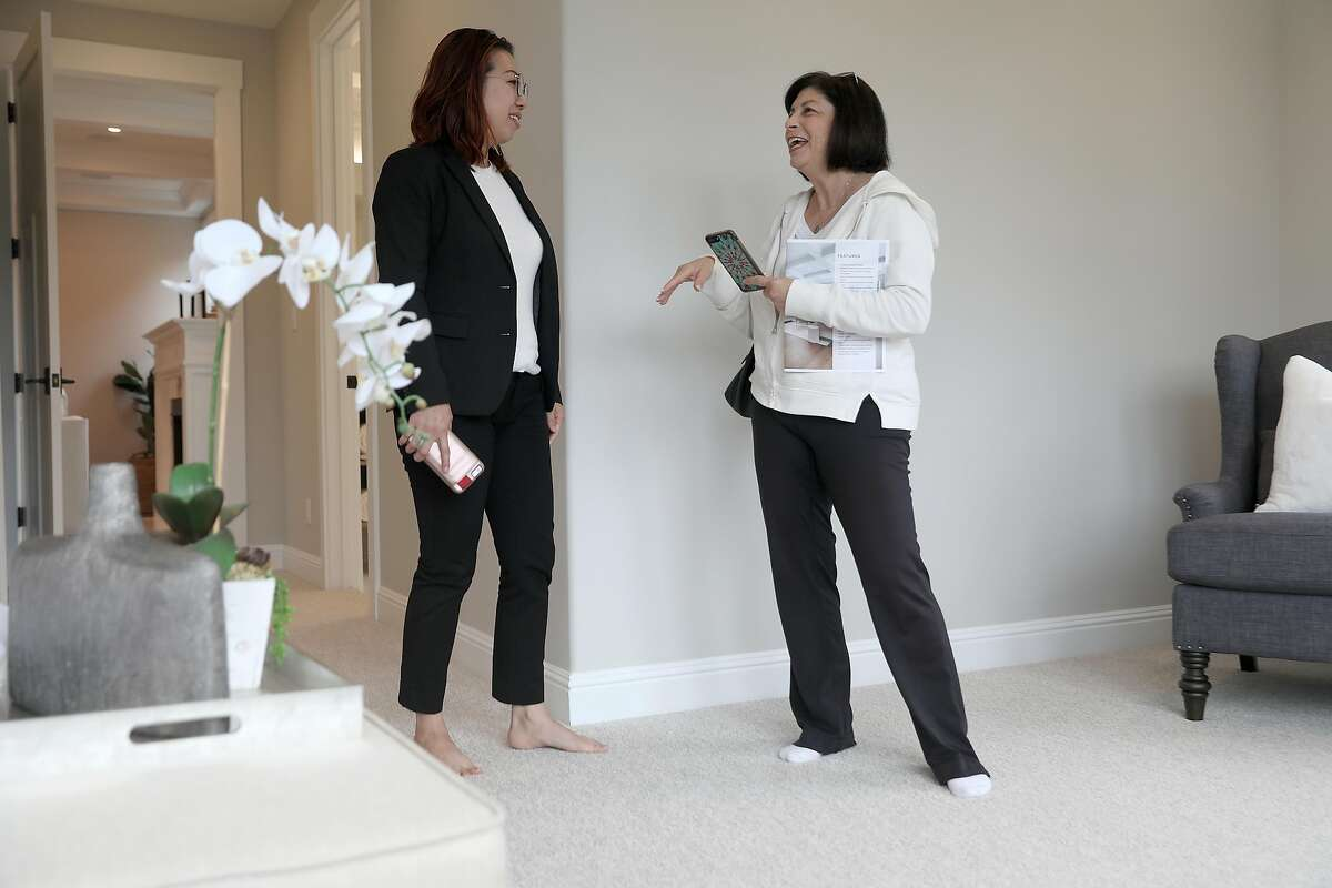 Realtor Denise Liew (left) speaks with visitor Joy Posnick (right) from Belmont doing renovation on her property and wanting to view 2133 De Anza Blvd., a new property listed for sale at $2.995,000 dollars, seen on Tuesday, Aug. 21, 2018 in San Mateo, Calif. The home is 4268 sq. ft. and is a 5 bedroom and 6.0 bath property. They are in one of the bedrooms which is on the main floor.