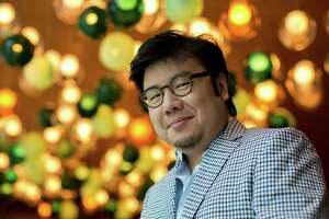 """Author Kevin Kwan poses in the lobby of the Shangri-La hotel. Kwan, author of the book """"Crazy Rich Asians,"""" which has been made into a movie and is receiving critical acclaim, will speak at the John Cooper School's Signature Authors Series on Friday, Nov. 30."""
