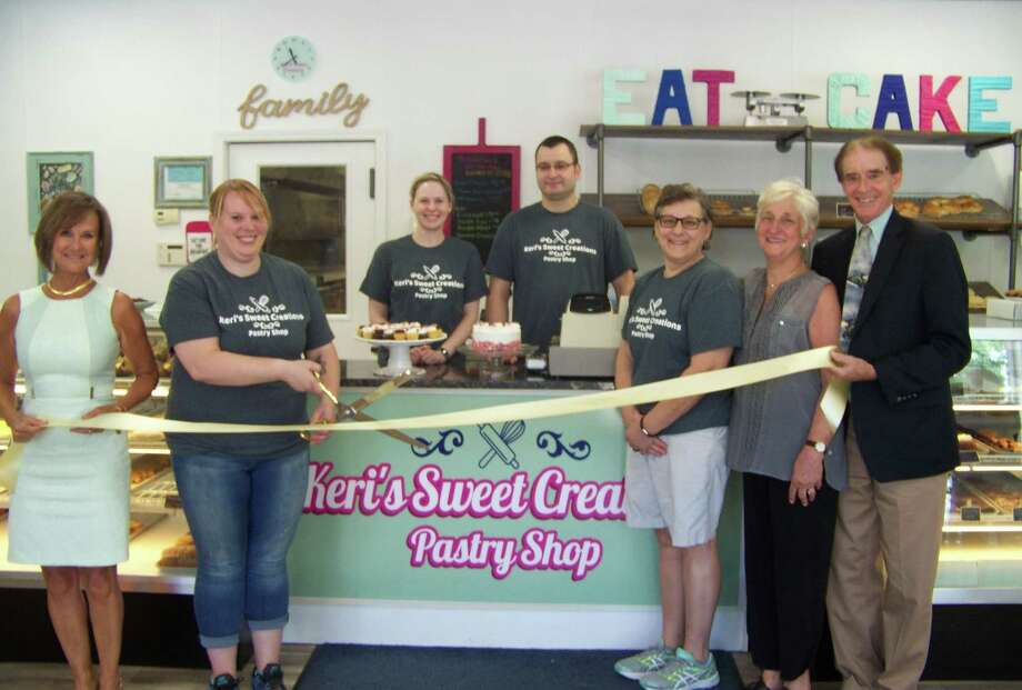 SWEET BEGINNING: From left, Quinnipiac Chamber of Commerice Executive Director Dee Prior-Nesti; owner and pastry chef Keri Logan-Ber; Business Manager Kristi Doerr; Ernest Ber; owner Marie Pascale; Wallingford EDC official Rosemary Preneta; and Wallingford Mayor William Dickinson attend a ribbon-cutting for Keri's Sweet Creations Pastry Shop, at 824 E. Center St. Keri Logan-Ber has extensive training, education and experience, including as head baker and pastry chef at Yale University and working side-by-side with many celebrity chefs and master chefs. Visit the bakery on Facebook for examples of what's offered. (Missing from photo is owner Mary Bachinsky). Photo: Contributed Photo
