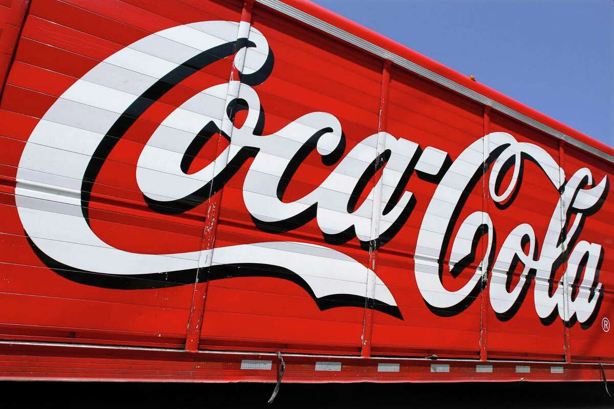 This June 25, 2012 file photo shows the Coca-Cola logo on the side of a delivery truck in Springfield, Ill.