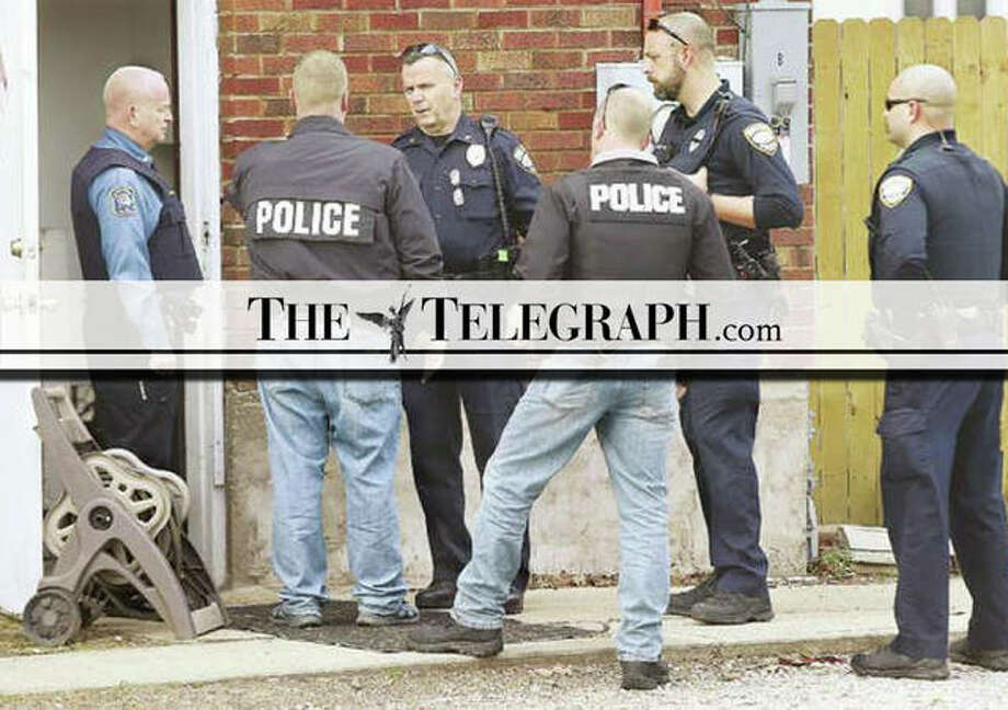 In this April 2018 file photo, Wood River and East Alton police meet at the scene of a raid. Photo: John Badman | Telegraph File Photo
