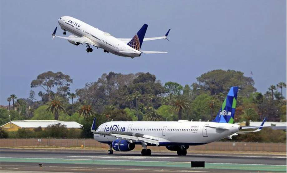 Today United said it is following JetBlue in imposing a $5 increase in baggage fees Photo: Jim Glab