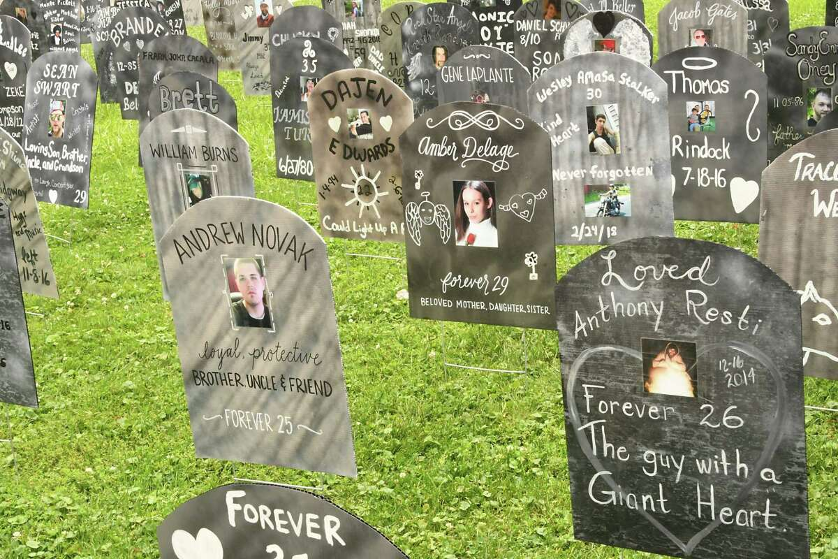 Lawn signs resembling gravestones are seen displayed as people gather in West Capitol Park to observe International Overdose Awareness Day (IOAD) by remembering those lost to overdose, and demand action to prevent future deaths on Friday, Aug. 31, 2018 in Albany, N.Y. (Lori Van Buren/Times Union)