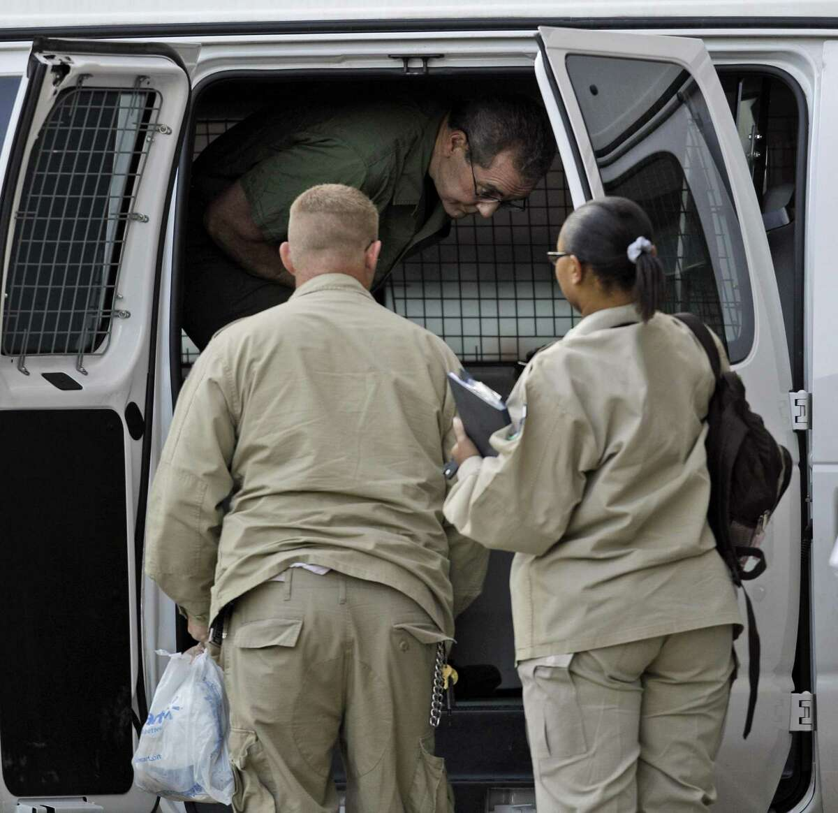 R. Allen Stanford arrives in custody at the federal courthouse for a hearing Tuesday, Aug. 24, 2010 in Houston. Investors and the court-appointed receiver in the Stanford Financial Ponzi scheme case have settled claims against Stanford's former counsel Proskauer Rose LLP.