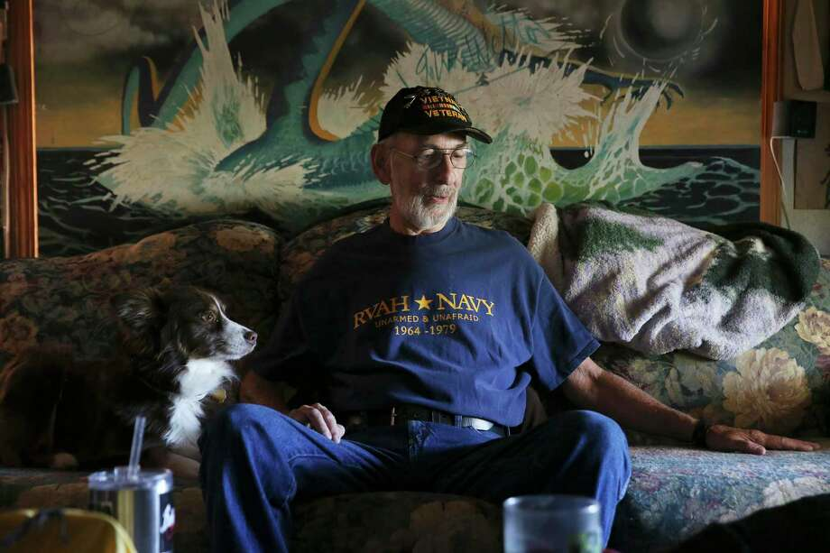 Vietnam veteran Michael Thompson, 67, talks about his Navy experience during an interview at his home near Medina Lake, Thursday, May 31, 2018. Thompson was exposed to Agent Orange while servicing planes on a carrier off the coast of Vietnam. He is fighting the Veterans Administration to recognize Blue Water Navy veterans as victims of Agent Orange exposure. Thompson suffers from several ailments his ascribes to Agent Orange. Photo: JERRY LARA / San Antonio Express-News / San Antonio Express-News
