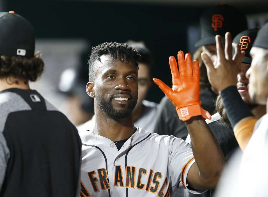 FILE - In this Aug. 18, 2018, file photo, San Francisco Giants' Andrew McCutchen, center, is congratulated in the dugout after scoring during the eighth inning of a baseball game against the Cincinnati Reds, in Cincinnati.The playoff-contending New York Yankees are close to completing a trade for San Francisco Giants outfielder Andrew McCutchen. A person familiar with the negotiations told The Associated Press on Thursday night, Aug. 30, 2018,  the Yankees would send infielder Abiatal Avelino and another minor leaguer to San Francisco for McCutchen. The person spoke on condition of anonymity because the deal wasn't finalized. (AP Photo/Gary Landers, File) Photo: Gary Landers / Associated Press