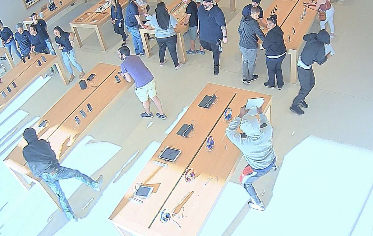 Police are searching for four suspects who stole electronics from the Apple store in Walnut Creek's Broadway Plaza on Aug. 25.