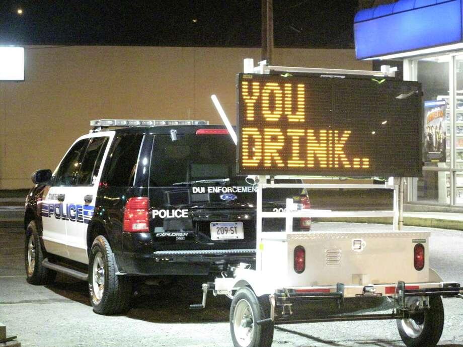 Darien Police, in conjunction with Stamford Police, conducted a DUI stop on East Main Street in Stamford. The checkpoint began at 11 p.m. Friday and continued through the early morning hours. Photo: Maggie Gordon / ST / Darien News