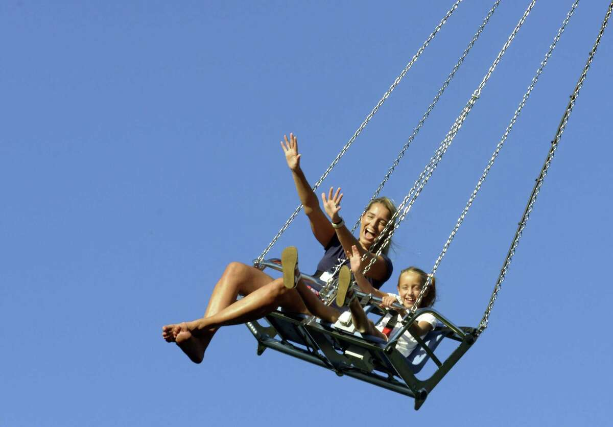 Marie DiPalma of Scarsdale, NY and her daughter Kate soar on Sky Hawk as they take in the 38th Annual St. Leo's Fair on August 30, 2018 in Stamford, Connecticut. DiPalma grew up in Stamford and has been coming to the fair since she was a child. The fair, offering family fun, amusement rides, good eating, live music, bingo and a $35,000 prize raffle, ends Saturday, opening at 2:00pm to 11:00PM.