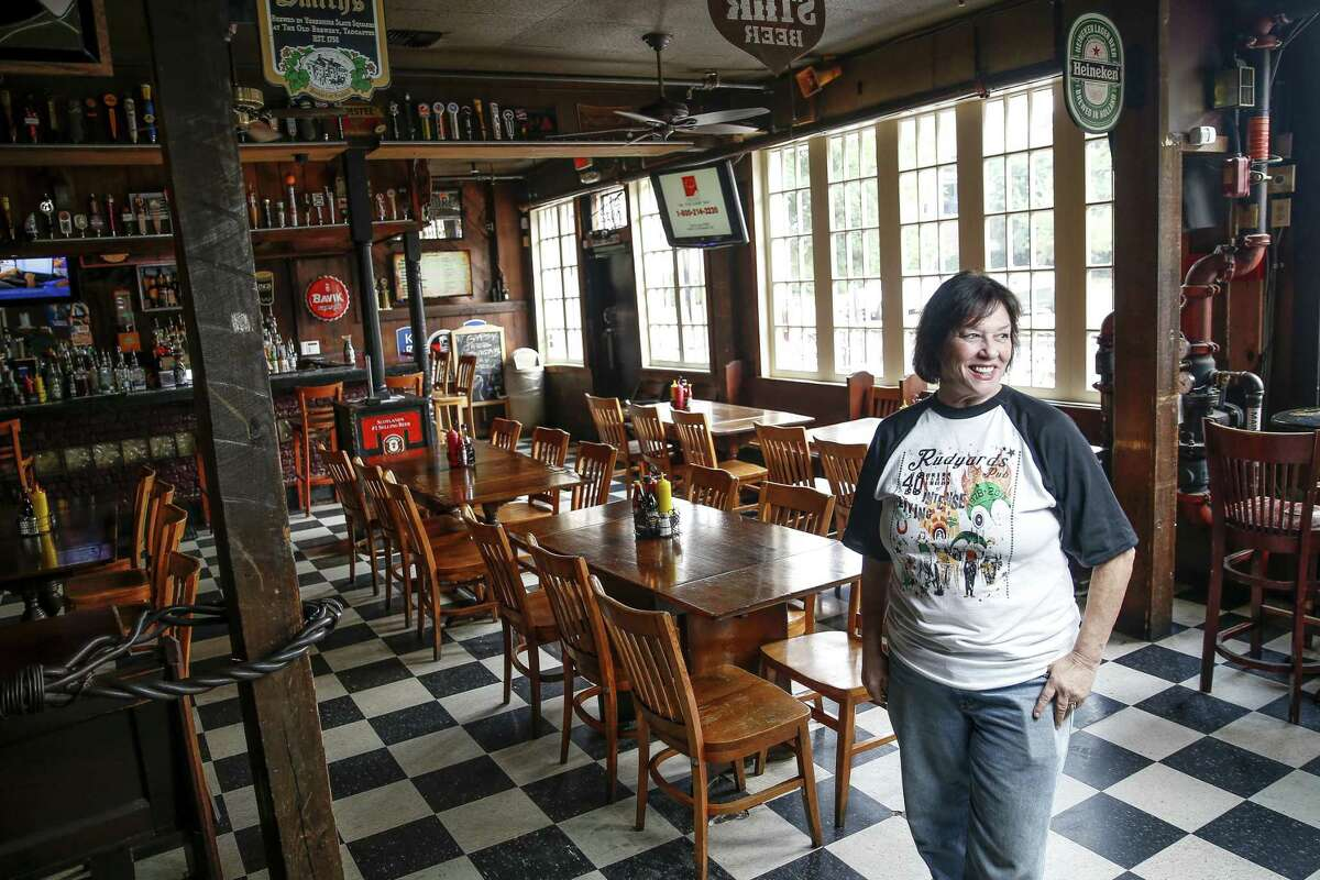 Rudyard's British Pub owner Lelia Rodgers stands in the bar Friday Aug. 24, 2018 in Houston. The pub is celebrating its 40th year anniversary this year.