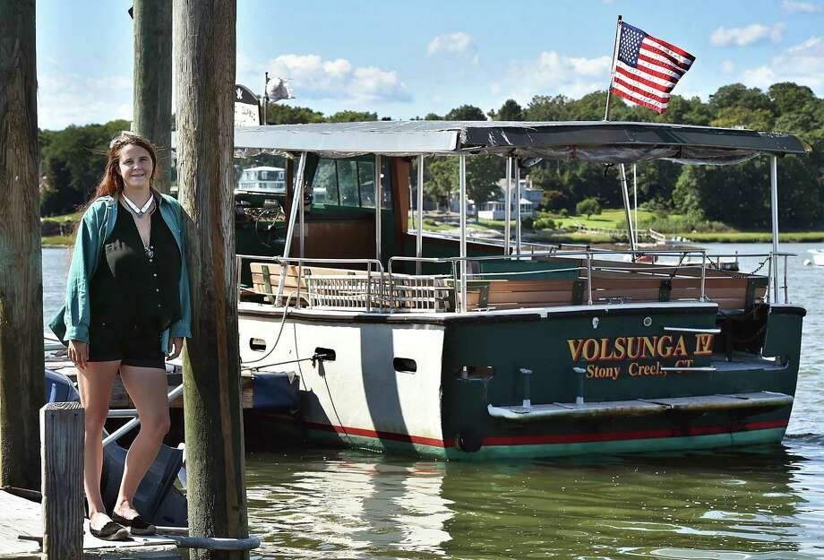 Captain Anna Milne, 26, aboard The Volsunga IV Thimble Islands Cruise, Thursday, August 23, 2018, in the village of Stony Creek in Branford. Milne took over the business in 2016 after her father Bob suffered traumatic brain injury as a result of a motorcycle accident. Photo: Catherine Avalone / Hearst Connecticut Media / New Haven Register
