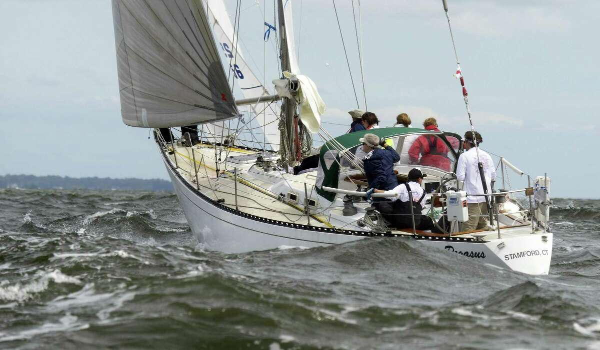 The crew of Pegasus, Skippered by Austin Royle of Wilton, Conn. head to opens waters of the Long Island Sound in heavy 3-4 foot swells at the start of the 2018 Vineyard Race on August 30, 2018 near Stamford, Connecticut.