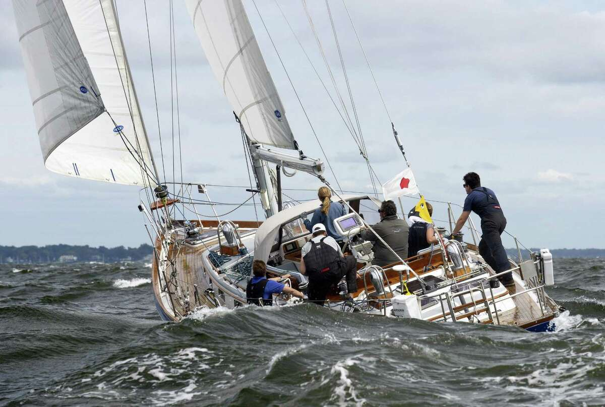 The crew of Rocinante, skippered by Ronald Weiss of Stamford, Conn., navigates heavy 3-4 foot swells on the Long Island Sound at the start of 2018 Vineyard Race on August 30, 2018 near Stamford, Connecticut.
