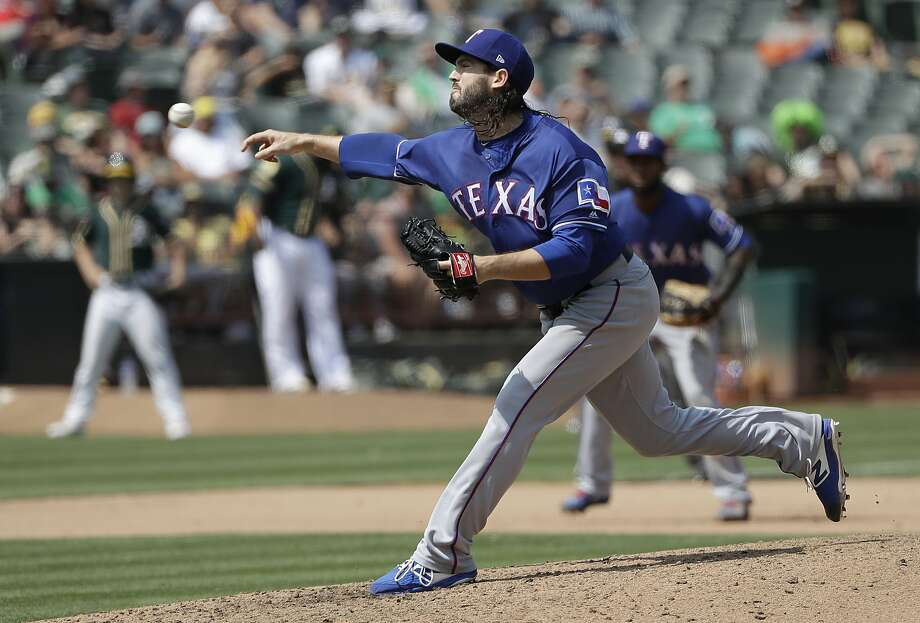 Texas Rangers pitcher Cory Gearrin throws against the Oakland Athletics during a baseball game in Oakland, Calif., Wednesday, Aug. 22, 2018. (AP Photo/Jeff Chiu) Photo: Jeff Chiu / Associated Press