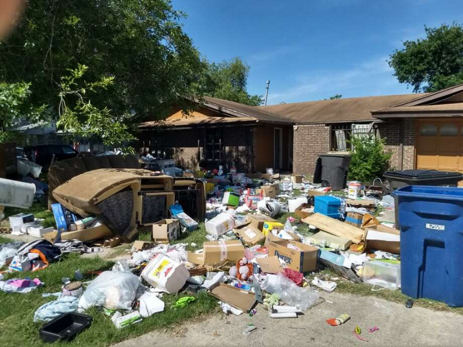 Matthew and Holly Roberts' household possessions were piled up outside the house they rented in the 1900 block of Harpers Ferry Street after they were evicted following a federal raid in April. Photo: Courtesy / William Polson