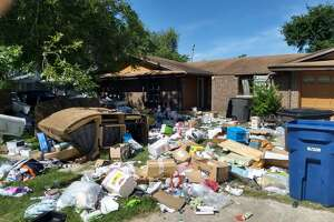 Matthew and Holly Roberts' household possessions were piled up outside the house they rented in the 1900 block of Harpers Ferry Street after they were evicted following a federal raid in April.
