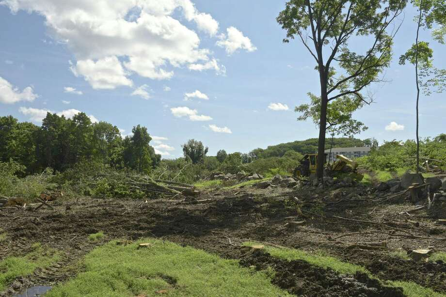 Toll Brothers has cleared trees to make way for a new housing development called Woodlands that will include 170 town homes. Thursday, August 30, 2018, in Danbury, Conn. Photo: H John Voorhees III / Hearst Connecticut Media / The News-Times