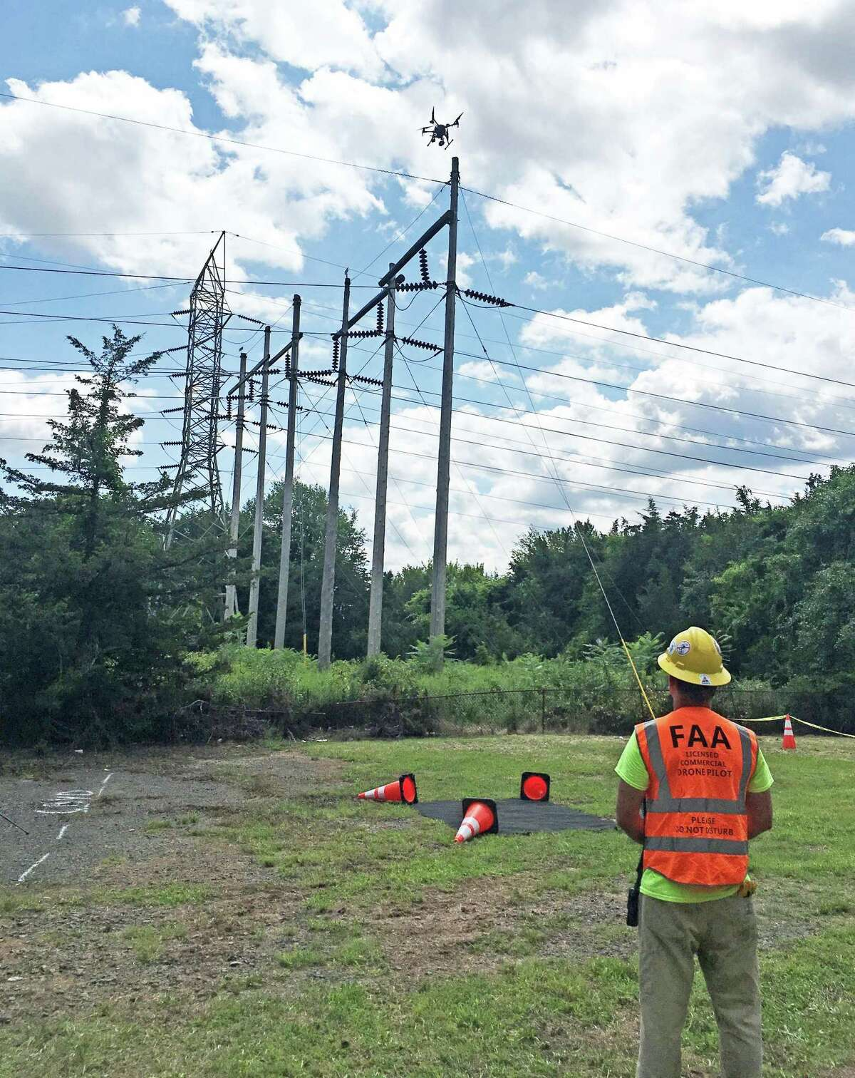 Eversource has begun employing drones to inspect electric lines in Connecticut, saying it will reduce costs and the impact on the environment caused by helicopters and trucks it uses.