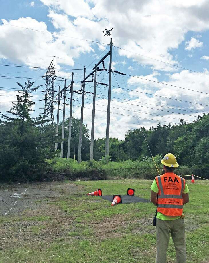 Eversource has begun employing drones to inspect electric lines in Connecticut, saying it will reduce costs and the impact on the environment caused by helicopters and trucks it uses. Photo: Contributed Photo / Contributed Photo / Norwalk Hour contributed