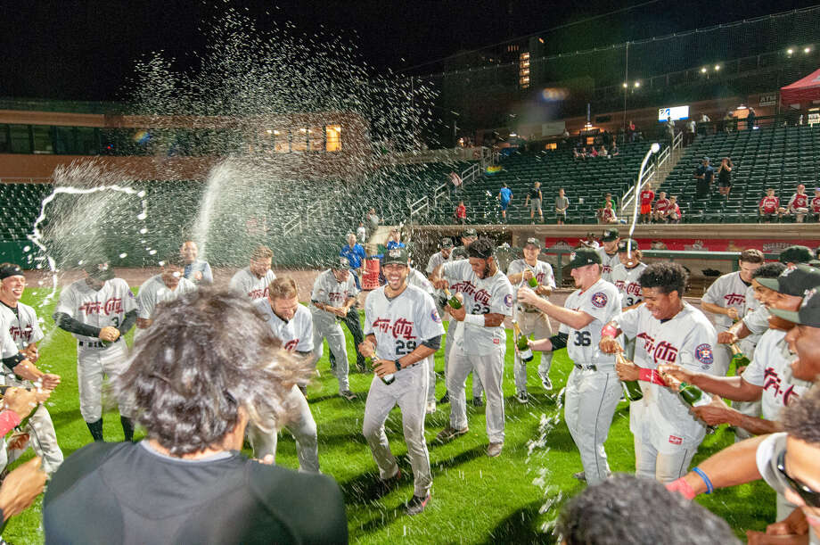 The Tri-City ValleyCats used champagne or grape juice, depending on age, to enjoy their division-clinching win at Lowell on Thursday, Aug. 30. (John Corneau/Lowell Spinners) Photo: John Corneau/Lowell Spinners