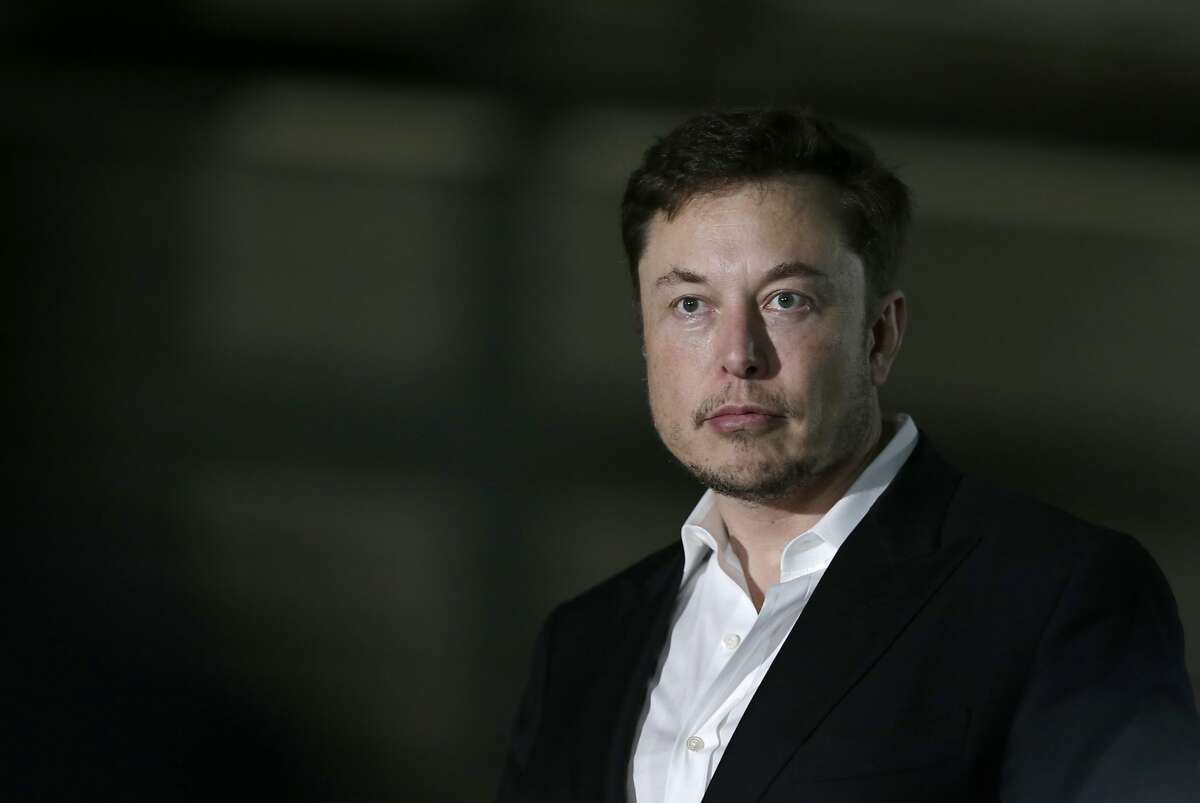 FILE- In this June 24, 2018, file photo Tesla CEO and founder of the Boring Company Elon Musk speaks at a news conference in Chicago. While Tesla grapples with internal issues like production delays, a sometimes-erratic CEO and a recent about-face on whether to go private, its rivals are moving aggressively into the luxury electric vehicle space. (AP Photo/Kiichiro Sato, File)
