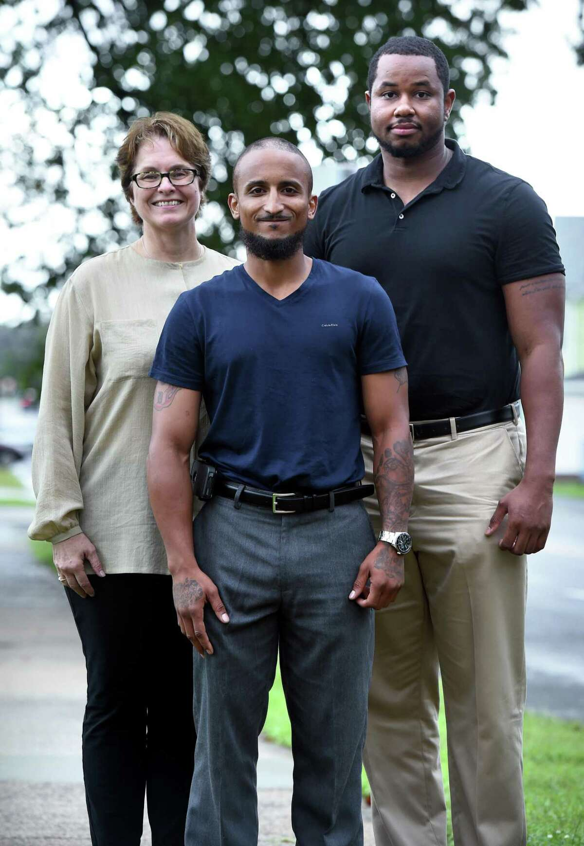 From left, Joy Haenlein, program director of Connecting Through Literacy: Incarcerated Parents, their Children and Caregivers, Robert Sullivan, graduate of CLICC, and Landon Osborn, CLICC program manager, are photographed in West Haven on Aug. 13.