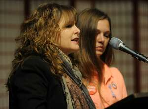 Abbey Clements, left, of Newtown, and Yvonne Crasso, of Middletown, wait to speak during the Vigil to #End Gun Violence at the Unitarian Church of Westport in Westport, Conn. on Sunday, December 10, 2017. Clements was a second grade teacher at Sandy Hook Elementary School during the mass killing five years ago.