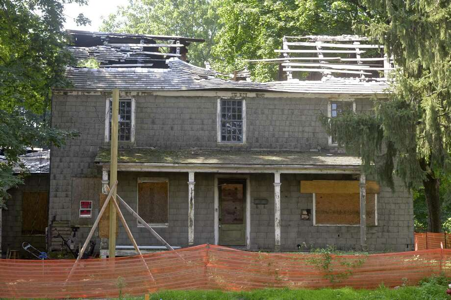 Historic Daniel Hickok house in Bethel, Conn, will be demolished in the coming weeks to make way for a new home. The house was extensively damage in a fire in 2014. Wednesday, August 29, 2018. Photo: H John Voorhees III / Hearst Connecticut Media / The News-Times