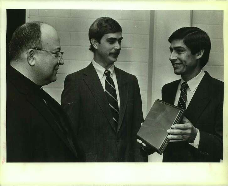 Father David Connell, Antonian principal is shown, in an unknown year, with Phil Crane, president of the Alumni Association and Judge Roy Barrera.