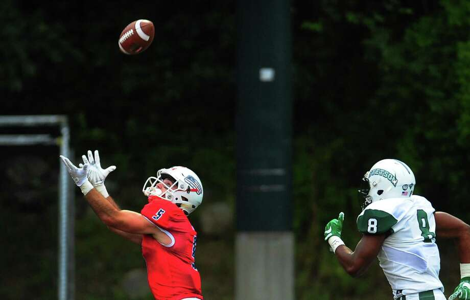 Sacred Heart University's Andrew O'Neill catches a touchdown pass during the season-opener against Stetson last season in Fairfield. Photo: Christian Abraham / Hearst Connecticut Media / Connecticut Post