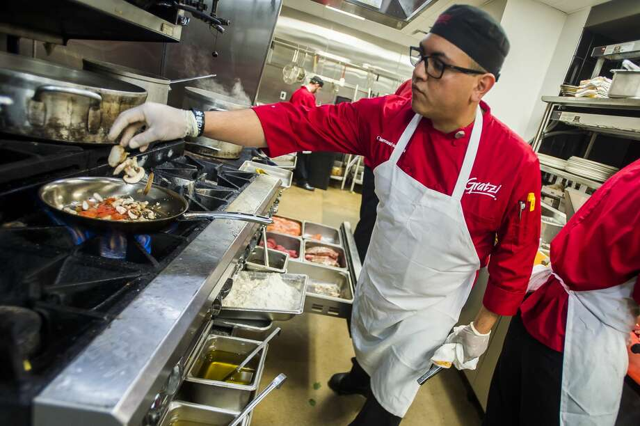 Gratzi Chef Ismael Herrera prepares a pasta dish on Friday at the restaurant, which won the 2018 Daily News Readers' Choice gold awards for best happy hour, most romantic dinner and best waitress. (Katy Kildee/kkildee@mdn.net) Photo: (Katy Kildee/kkildee@mdn.net)