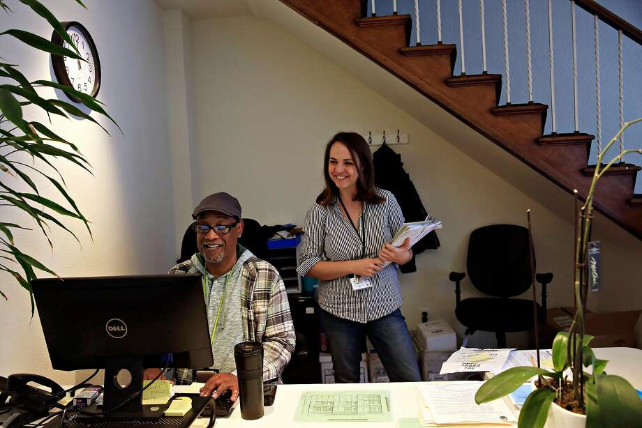 Julius Crane (left), who manages administration and operations, and Holly Aversano work at one of the city's new Access Points. Photo: Photos By Lea Suzuki / The Chronicle