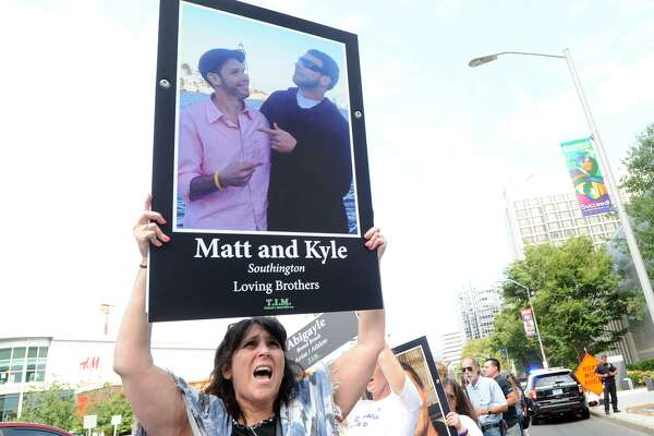 """It all started at Enfield High School when someone gave them some of those damned OxyContin pills,"" said Elizabeth Fitzgerald of Enfield (pictured here) about the overdose deaths of her sons, Matt and Kyle Fitzgerald (pictured on the poster photo), as Fitzgerald participated in the International Overdose Awareness Day demonstration with other protestors outside Purdue Pharma's headquarters at 201 Tresser Blvd., in downtown Stamford, Conn., on Aug. 31, 2018. Purdue Pharma is the maker of the opioid pain medication, OxyContin, a drug the protestors say is highly addictive and is responsible for the deaths of their loved ones."