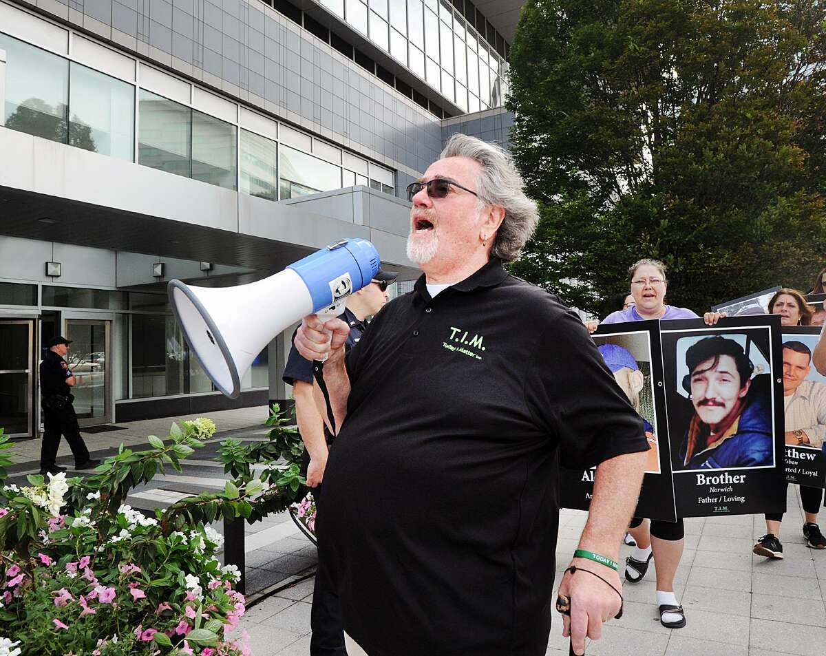 John Lally of Ellington led demonstrators during International Overdose Awareness Day as protestors assembled outside Purdue Pharma's headquarters at 201 Tresser Blvd., in downtown Stamford, Conn., on Aug. 31, 2018. Lally said he lost her son Tim Lally in 2016 and that he was a vistim of the opioid crisis. Purdue Pharma is the maker of the opioid pain medication, OxyContin, a drug the protestors say is highly addictive and is responsible for the deaths of their loved ones.