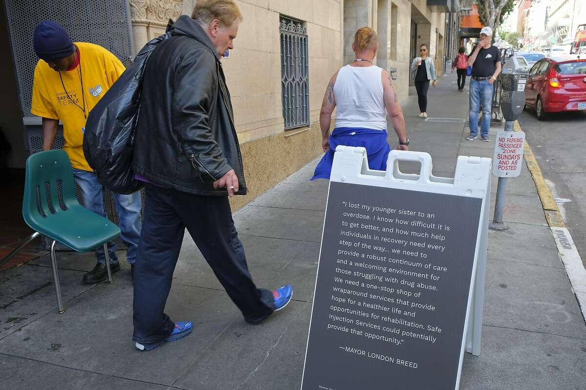 In this photo taken Wednesday, Aug. 29, 2018, words from Mayor London Breed are displayed outside the entrance to Safer Inside, a realistic model of a safe injection site in San Francisco. The model is an example of a supervised, indoor location where intravenous drug users can consume drugs in safer conditions and access treatment and recovery services. (AP Photo/Eric Risberg)