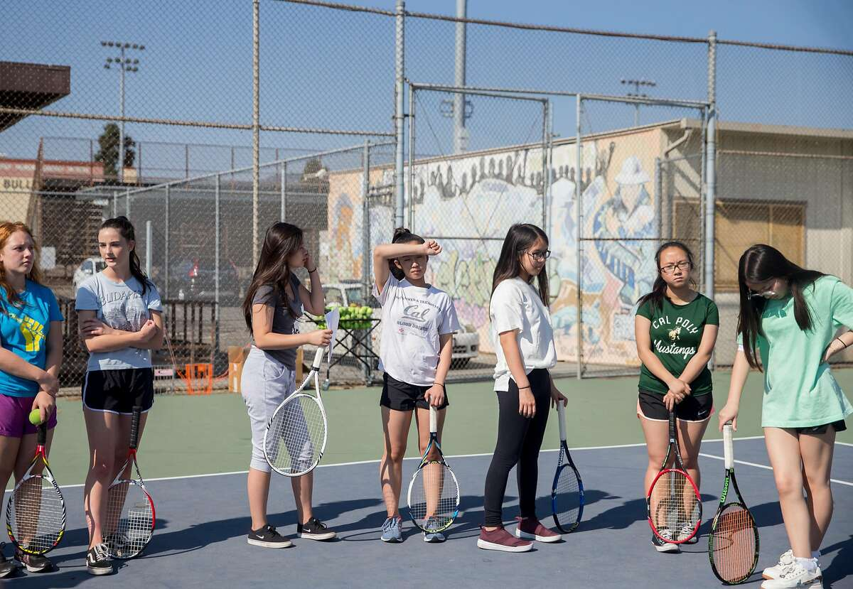 Members of the Oakland Tech girls tennis team line up while listening to Coach Marlin Eagles during a practice at Oakland Tech in Oakland, Calif. Thursday, Aug. 30, 2018.