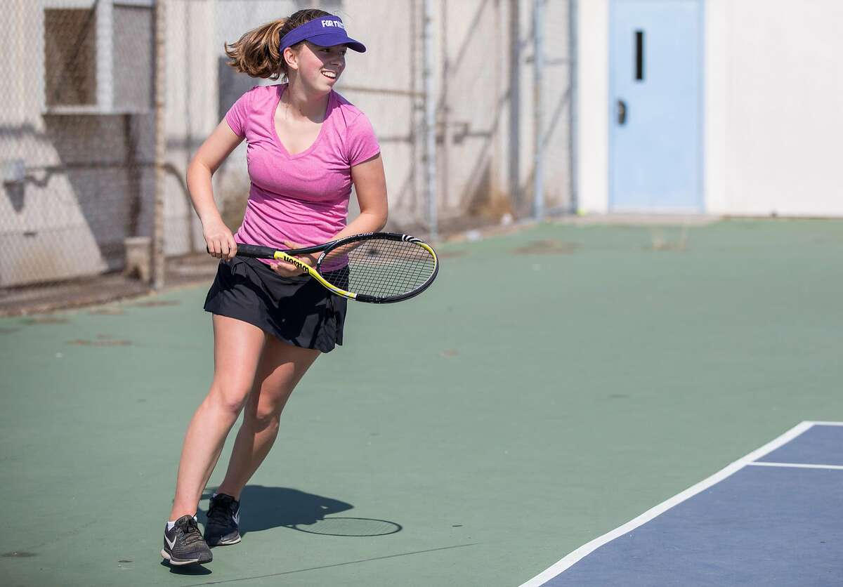 Gabby Sands practices with the Oakland Tech girls tennis team at Oakland Tech in Oakland, Calif. Thursday, Aug. 30, 2018.