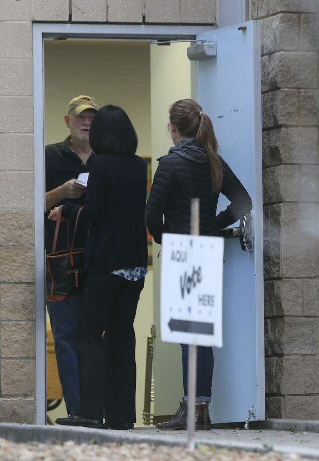 People line up to vote at the Brook Hollow Library  in March. On the ballot in November will be judicial candidates who run as Republicans and Democrats, which means in a blue-wave or red-wave election, good judges could be removed from the bench. Photo: Staff File Photo / ©John Davenport/San Antonio Express-News
