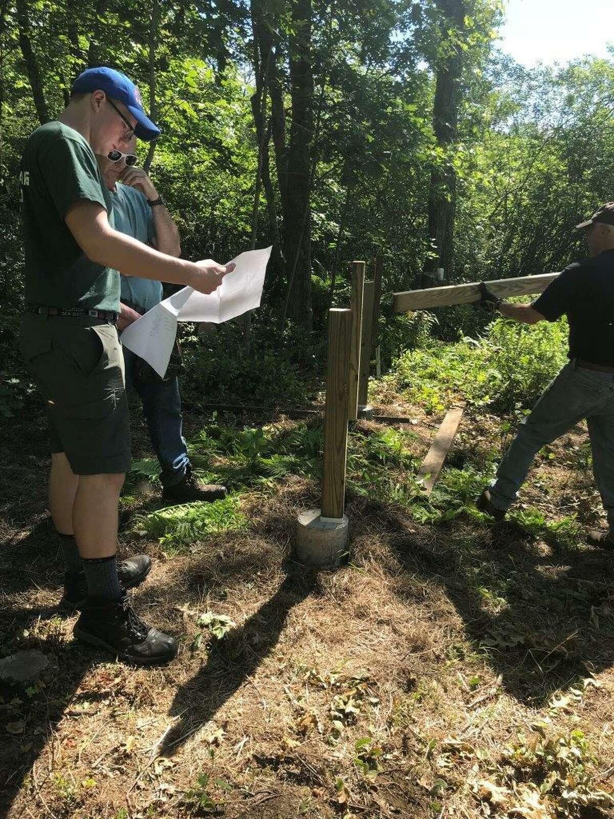 Boy Scout Joseph Sefcik discusses the plans with his Eagle Scout project coach, Ed Pitcher.