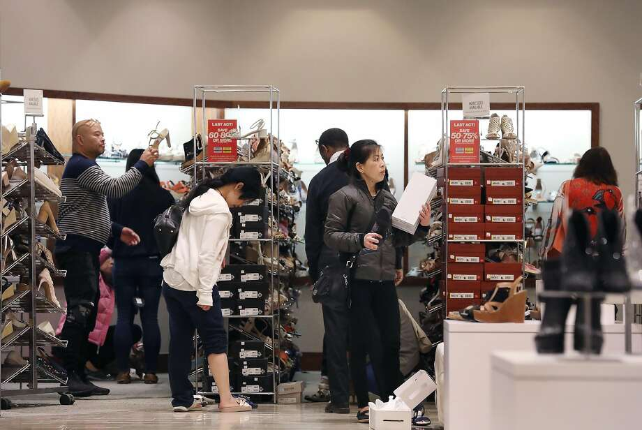 Lots of customers are in pursuit of women's shoes as they shop at Macy's in Union Square. Some are offered at deep discounts. Photo: Photos By Lea Suzuki / The Chronicle