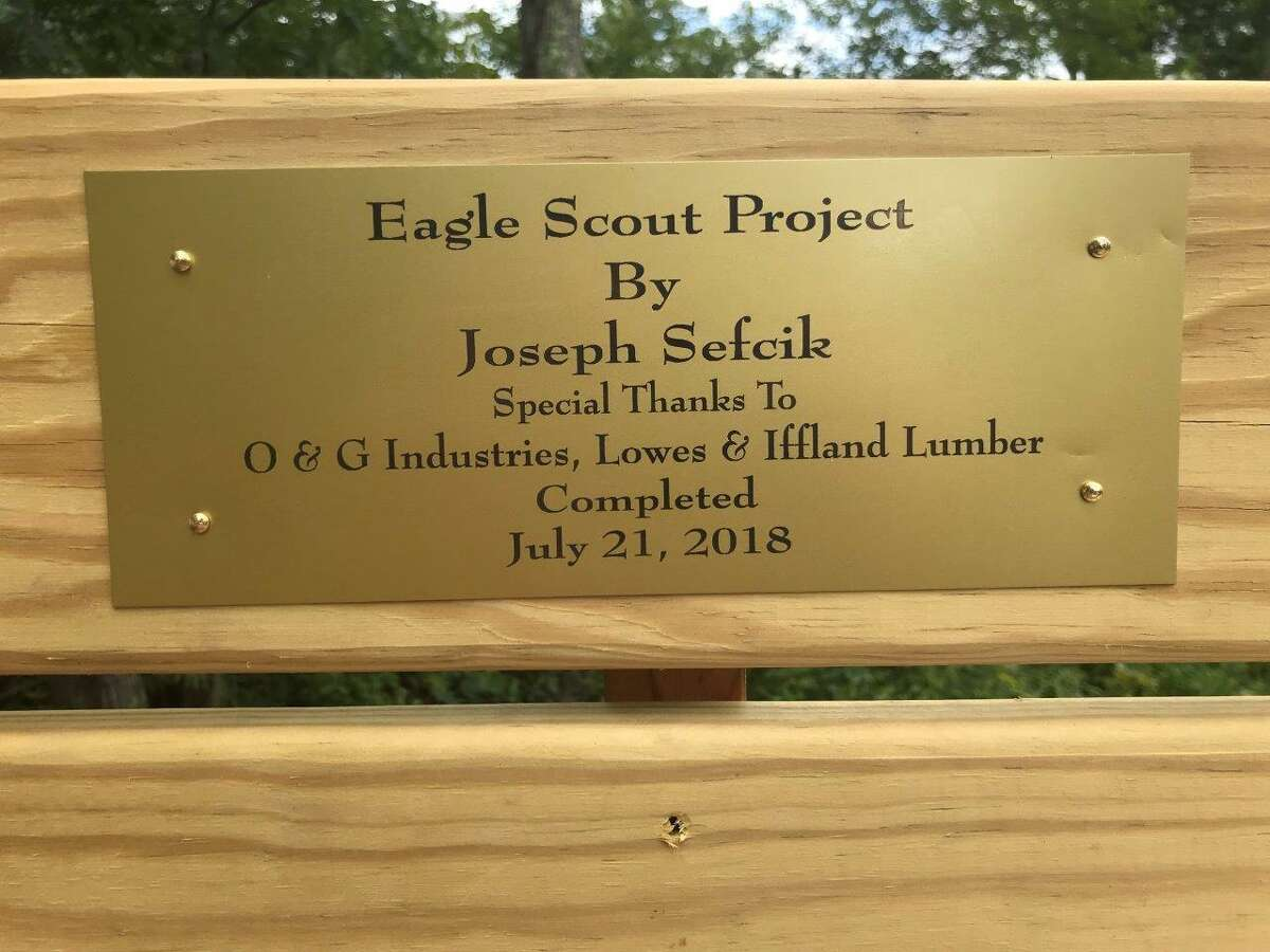 Boy Scout Joe Sefcik recently held a ribbon cutting to mark the completion of his Eagle Scout project. The comemmorative plaque acknowledged his supporters.