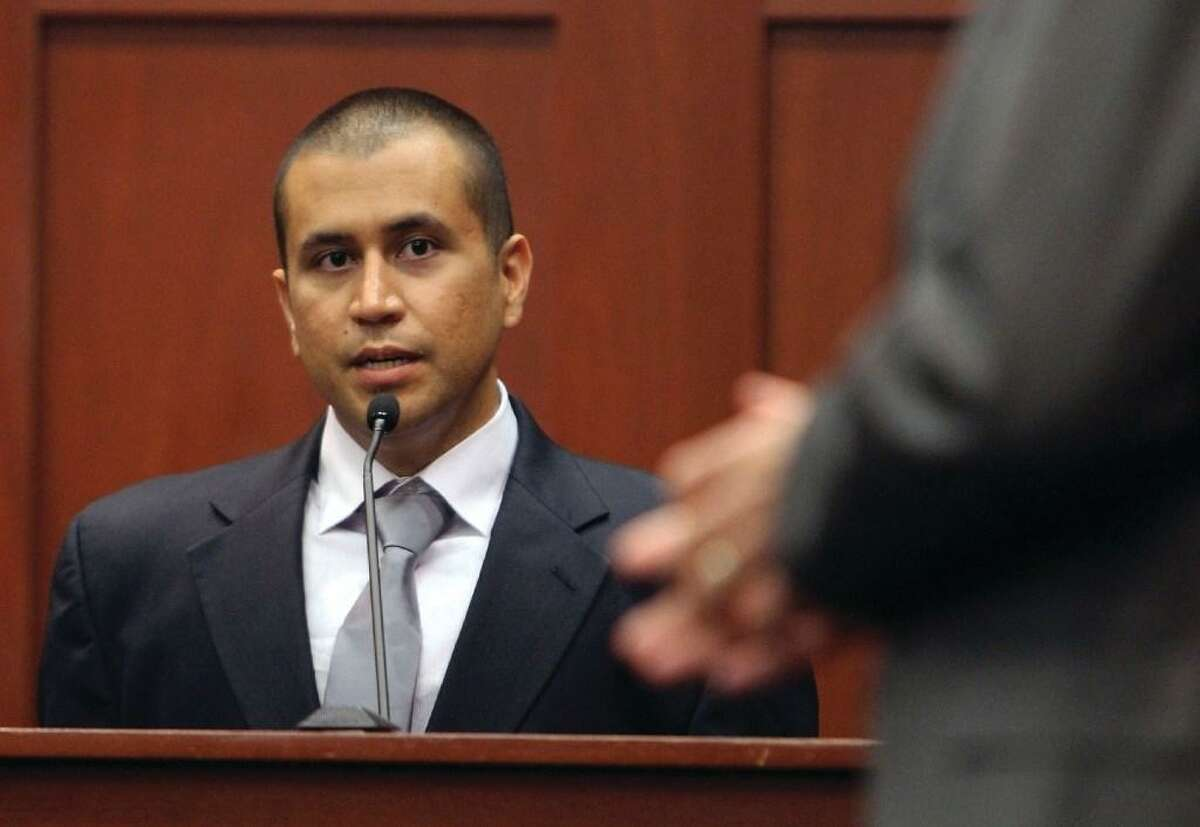 In this April 20, 2012 file photo, George Zimmerman, left, answers a question from attorney Mark O'Mara during a bond hearing in Sanford, Fla. A reader says racism charge about his acquittal ignores the law.