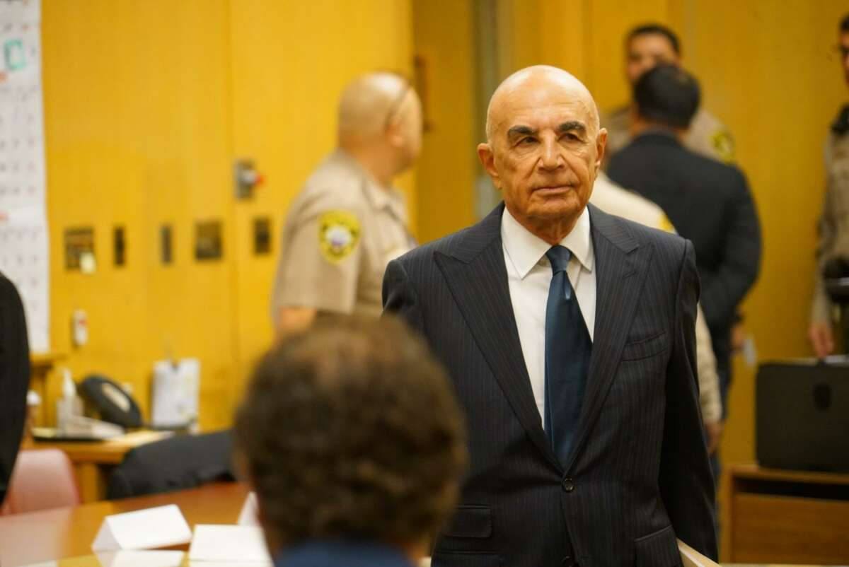 Famed defense attorney Robert Shapiro stands in San Francisco court as his client, Gurbaksh Chahal, is led away in handcuffs Friday.