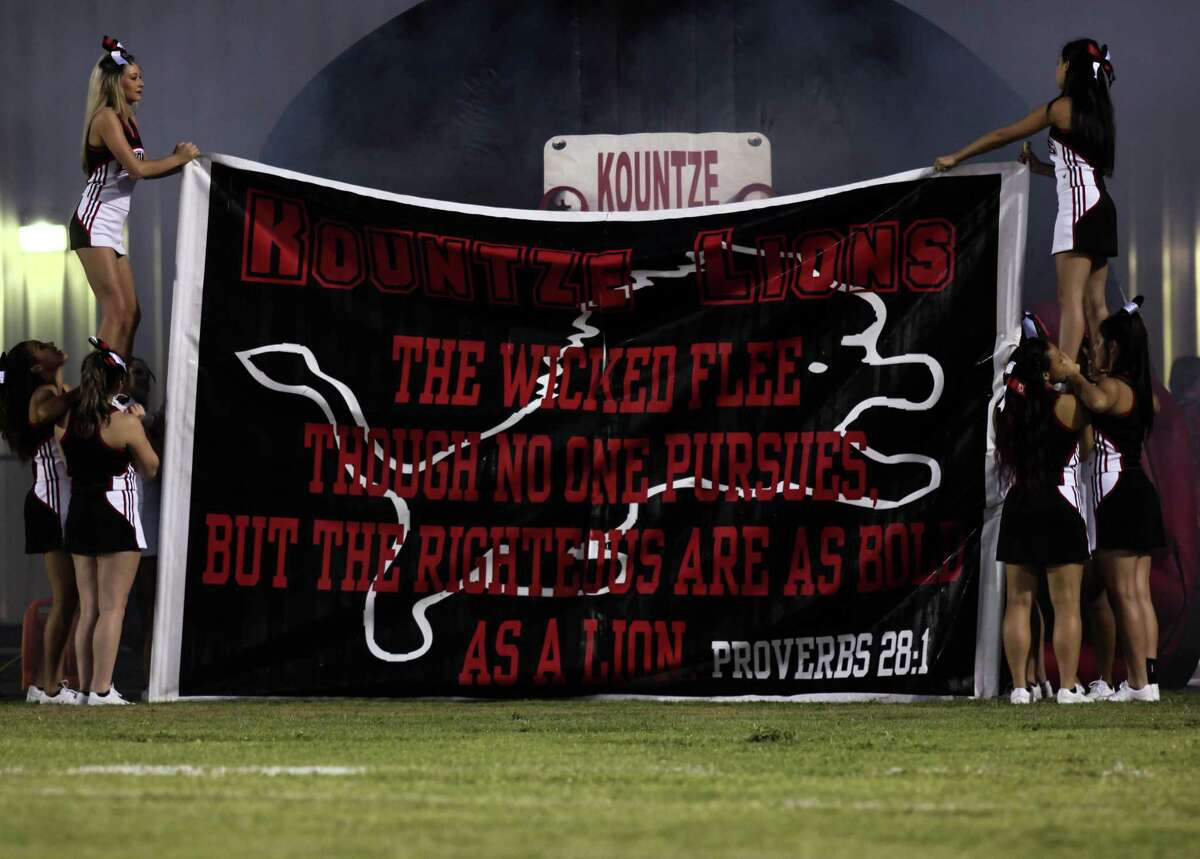 Kountze Lion's cheerleaders hold up a banner Friday Night at the Lion's Stadium. Photo provided by Denzel Seale.