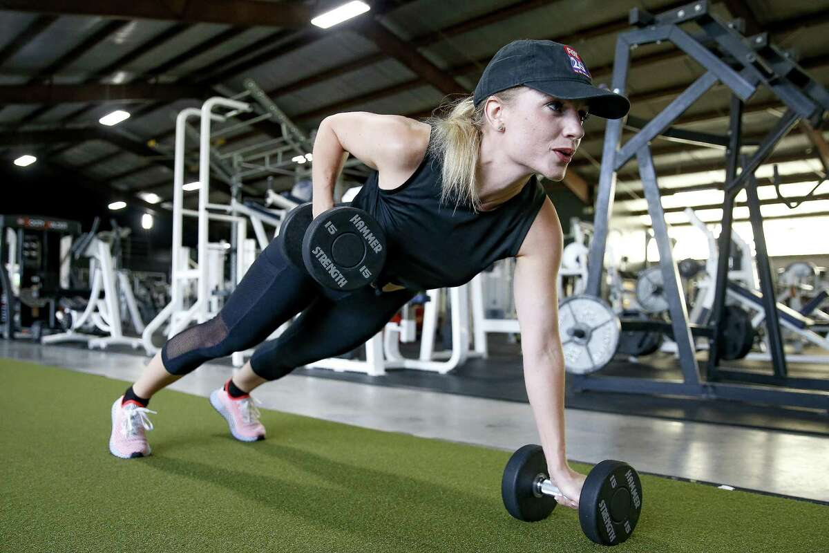 Fox 26 reporter Ivory Hecker does a push-up row as she works out at Alphalete Gym Thursday Aug. 30, 2018 in Stafford.