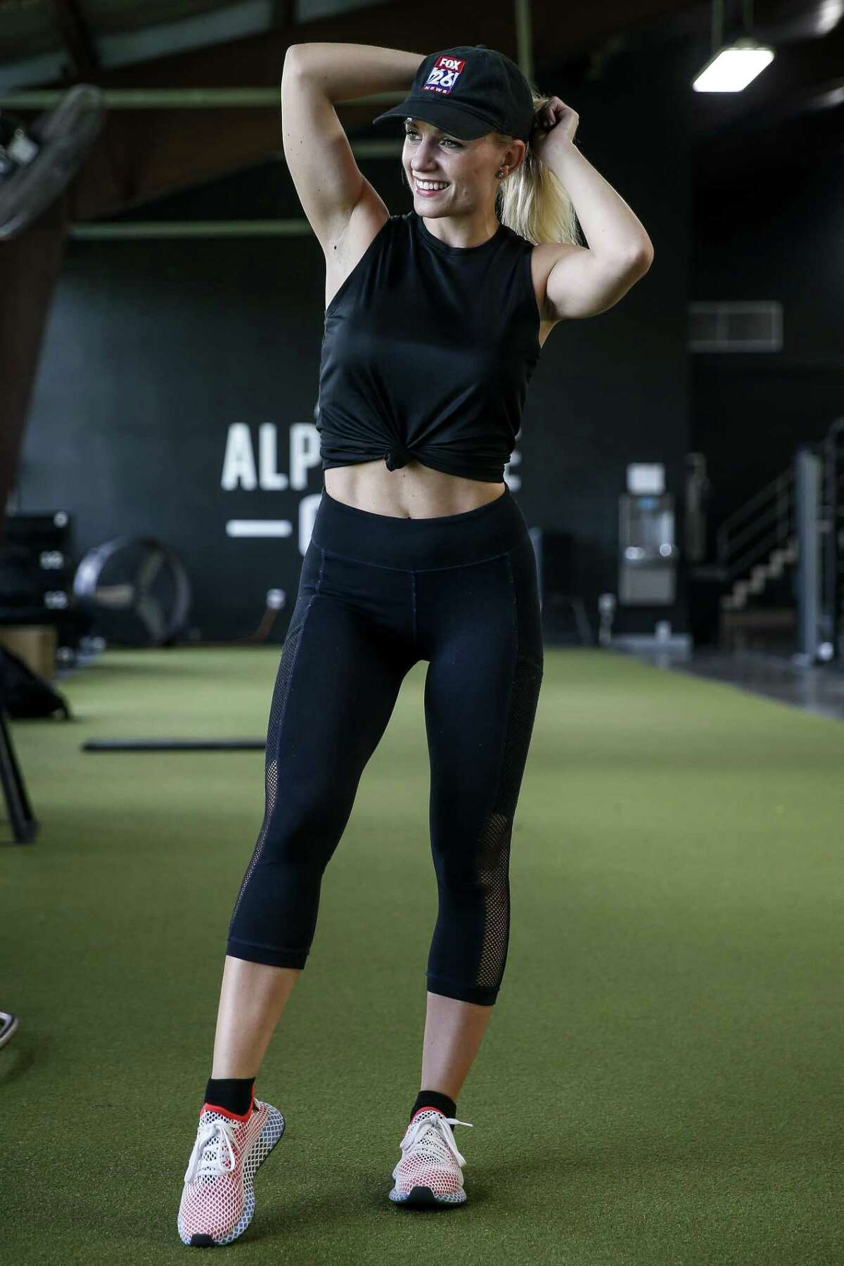 Fox 26 reporter Ivory Hecker poses for a portrait after working out at Alphalete Gym Thursday Aug. 30, 2018 in Stafford.